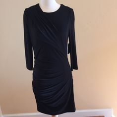 """☃Softly Gathered Little Black Dress Juicy Couture Brand New Juicy Couture Jersey Knit Side Draped """" Little Black Dress""""! Simple Elegance!!  3/4   Sleeve , Round Neck, Side Zipper and Gorgeous Gathering on both sides on the Dress and on the Right side on the neckline. 95% poly 5% elastane. Brand new, never worn. Fully lined. 16 1/2"""" across the chest. 13 1/2"""" waist. 17"""" hips. This fabric has quite a bit of stretch to it. Juicy Couture Dresses"""