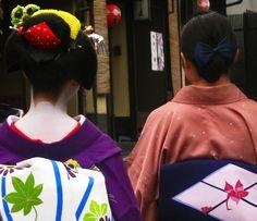 Maiko Katsuyuki & Geiko Katsugiku Another photo I took of Maiko Katsuyuki and Geiko Katsugiku while walking in the Gion Geisha District of Kyoto, Japan. I just love Katsuyuki's Kanzashi (hair ornaments)!
