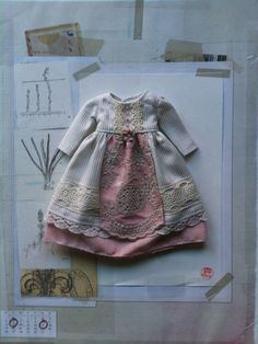 A lovely primly styled dress made from soft grey striped cotton and vintage lace. The bodice has seed bead buttons and the skirt has a layered