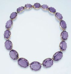 An Antique Amethyst Riviere.   Composed of eighteen graduated oval-cut amethysts, mounted in rose gold, circa 1860, 15 ins.                           PROPERTY FROM THE CHARSKY COLLECTION OF ANTIQUE JEWELRY 2 October 2003, New York, Rockefeller Plaza