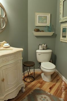 Powder room slate green glidden paint -Makeover-----great idea to have empty frames used a gallery wall.  To see more photos of this and her powder room, visit: http://theinspiredroom.net/2013/02/13/small-bathroom-makeover-before-and-after-photos/