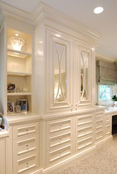 Bedroom built-in wardrobes - great mirror detail and in cabinet lighting