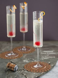 Celebrate the holidays with the Bubbly French 75 Cocktail, a fun alternative to plain champagne. Ingredients: 1 tablespoon lemon juice 1 oz vodka 1 teaspoon superfine sugar Champagne or Spanish Kava 1 marachino cherry orange or lemon twist Cocktails Champagne, Cocktail Drinks, Champagne Glasses, Refreshing Drinks, Yummy Drinks, Healthy Cocktails, Marachino Cherries, French 75 Cocktail, Jus Detox