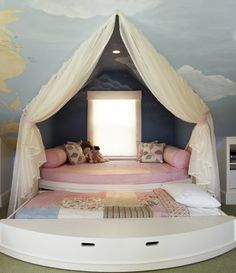 Round bed with a pull out trundle bed