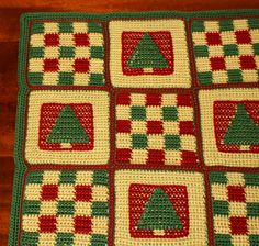 Patchwork Crochet Christmas Afghan Patchwork Crochet Christmas Afghan  By Amy Solovay, About.com Guide Crochet a Christmas Afghan With Pine Tree Motifs