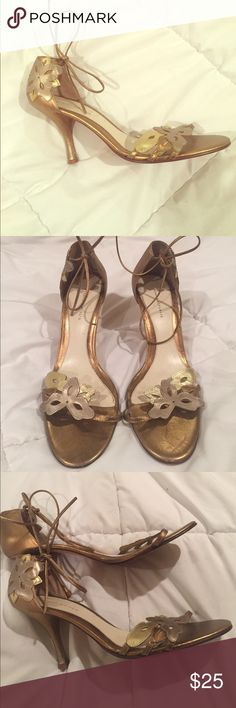 Gorgeous gold Banana Republic tie up heels So sad to let these go. Gold BR lace tie heels with gold flowers that adorn the heel and strap across foot. Very elegant and deserving of a good home! Paid a pretty penny for these and only wore once Banana Republic Shoes Heels