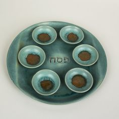 Michal Ben Yosef Ceramic Seder Plate available from the Spertus Shop at Chicago's Spertus Institute for Jewish Learning and Leadership. http://shop.spertus.edu/product/michal-ben-yosef-ceramic-seder-plate/
