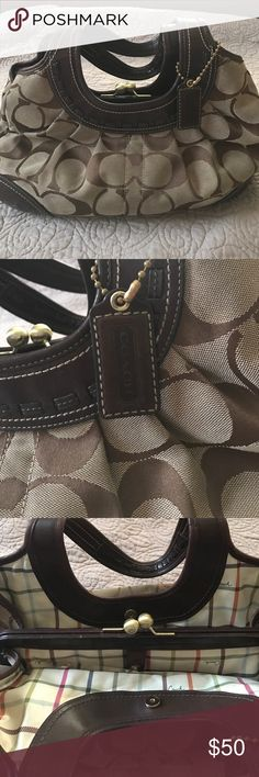 100% Authentic Coach Handbag Adorable 100% Authentic Coach Handbag in great condition. Very very roomy I actually have a black patent one that I love. There's a Small Ink stain on inside of one of the sections I showed in pic. A small wear on top of middle section also in pics. Bag has smell of perfume. Style B0869-12232. Very trendy. Coach Bags Hobos
