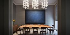 Dining space.  Love the simple dining table and chairs to offset the wow art and lights.