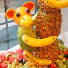 I must make a fruit monkey! Pineapple Tree Centerpiece with Fruit Monkeys, for a luau party - from Kennedy Treats Fruit Party, Snacks Für Party, Food For Luau Party, Fun Fruit, Fresh Fruit, Pineapple Tree Centerpieces, Monkey Centerpiece, Centerpiece Ideas, Cute Food