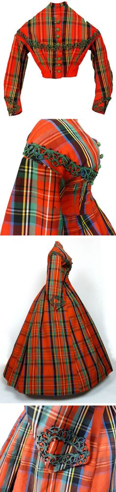 Plaid wool day dress ca. 1860s. Trimmed in green soutache, with green buttons at center front. Two pieces. Sara Elizabeth Gallery Facebook