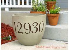 house number on flower pot