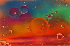 """Fine Art Photography - """"Celestial Obsession 4"""" - An eye catching mixture of colors (red, green, fuschia, teal, dark shades of orange yellow, dark peach, blue, pink, yellow, aqua, iridescent, purple, violet and white) make up this unusual oil and water abstract photograph with clusters of bubbles. Contemporary."""