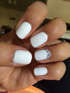 White gelish nails with accent iridescent rhinestones by Gel Nails by Jonae