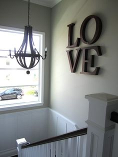'love' in tangerine with pavement color painted wall. This will tie in with front entrance colors.