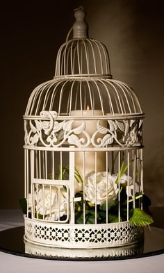 vintage Birdcages look wonderful as a wedding centre piece. www.granddesignweddings.co.uk