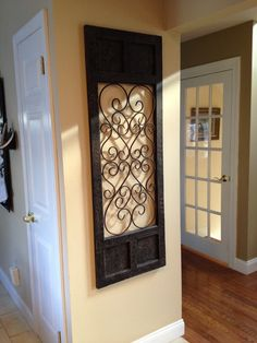 wrought iron wall decor. I love wrought iron for the walls :)