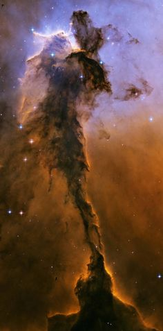 Appearing like a winged fairy-tale creature poised on a pedestal, this object is actually a billowing tower of cold gas and dust rising in the Eagle Nebula. The soaring pillar is 9.5 light-years, or about 57 trillion miles, high, about twice the distance from our Sun to the nearest star. Stars in the Eagle Nebula are born in clouds of cold hydrogen that reside in chaotic neighborhoods, where energy from young stars sculpts fantasy-like landscapes in the gas.