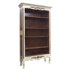 This Provencal bookcase is finished in a light cherry and ivory color that perfectly complement and contrast each other. The sturdy wood construction ensures a long lasting bookcase that looks great in any room.