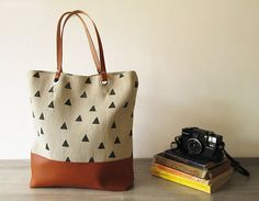 FRIDAY FRENZY | etsy find of the day 2 | 11.15.13 geometry triangles canvas tote by bymart  math nerds are going to LOVE this geometry-inspired, printed tote. i love the mixed neutrals — tan and cognac and charcoal, plus a black lining.