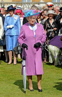 June 2008 | The Queen hosts a garden party at Buckingham Palace, and we're loving the sheer umbrella. via @stylelist