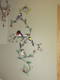 Looking for ideas to decorate a blank wall? What about a stained glass wall art? It's an eye-catching option which is quite different from the most popular art canvas or photo collections. Stained Glass Birds, Stained Glass Suncatchers, Stained Glass Crafts, Stained Glass Designs, Stained Glass Panels, Stained Glass Patterns, Leaded Glass, Mosaic Glass, Tiffany Glass