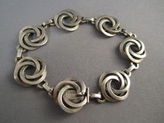 The ebay listing is gone for this vintage danish bracelet. I belive I've seen this done with jump rings and without the flat connecting links. I like this much more.