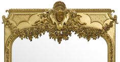 A Very Fine and Palatial French 19th Century Louis XV Style Carved Giltwood and Gesso Figural Mirror Frame Trumeau. The arched plate within a main foliate and acorn trailing border, surmounted by ribbon tied floral swags centered by a mask flanked by putti. Circa: Paris, 1890