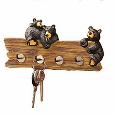Big Sky Carvers Bear Key Holder Big Sky Carvers Bear foots Collection Charming key holder 4 hooks for hanging keys Materials: hand-cast resin, iron Measurements: Inch wide x Inch high You Come And Go, Key And Letter Holder, Kitchen Utensil Holder, Bear Decor, Key Rack, Hanging Racks, Wall Racks, Lodge Decor, Thing 1