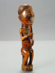 Africa | Sculpture of a Seated Chief from the Baule people of the Ivory Coast | 20th century | Ivory