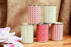 Cover cans with coordinating scrapbook paper for a simple and easy ball/beanbag toss party game