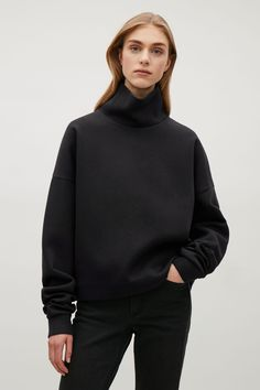 COS image 7 of Oversized high-neck sweatshirt in Black Cos Tops, Cut Sweatshirts, Winter Wear, Lounge Wear, High Fashion, What To Wear, Clothes For Women, Model, Fashion Design