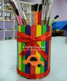 Recycled Popsicle stick pencil holder by Crafty Crafted, featured @totgreencrafts