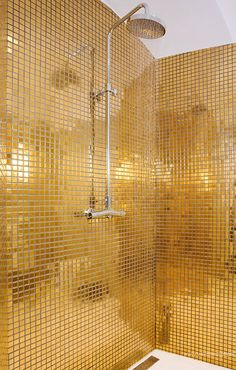 metallic gold mosaic bath tiles #disco..cool to look at, not sure about living with it. Maybe in guest cottage