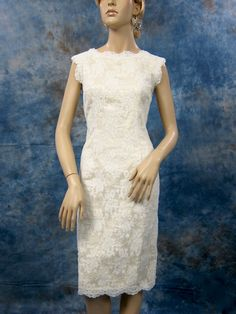 Ivory bridesmaid dress made of alencon lace with champagne satin lining. $159.99, via Etsy.
