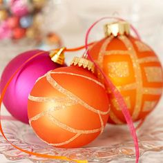 Redecorating solid ornaments with a little glitter and glue will add extra dazzle to your holiday tree.