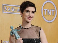 """Anne Hathaway wins the award for outstanding performance by a female actor in a supporting role for her part as Fantine in """"Les Miserable."""" (Photo: Chris Pizzello / AP) #SAGAwards"""