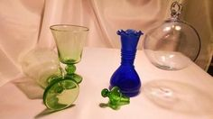 Renaissance Style _ Blown Glass Sleeping Beauty Drink ware Set_ from Mystic Land. Green transparent Stemware, one Transparent Clear 6 inch hanging glass ball, and dark blue Decanter 5.5 inch High