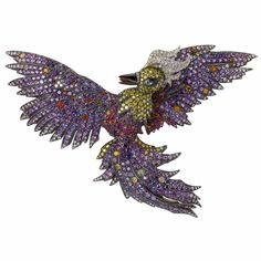 Fabergé. Yellow gold brooch with white, yellow, pink and black diamonds, violet, pink, and Padparadscha sapphires, rubies, amethysts, spessartites, opals and moonstones.