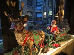 A German made 1920's Santa in sleigh with reindeer made for FAO Schwarz on the windowsill in the study