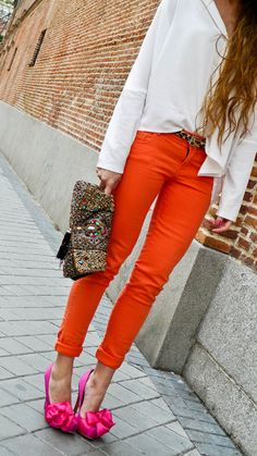 Her style makes me smile! dont you think the shocking pink shoes are gorgeous with the orange?