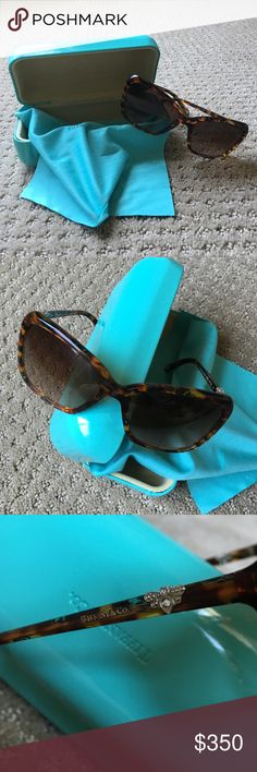 ❤️TIFFANY&CO SUNGLASSES❤️ Tried on a few times but never worn! Comes with case! SOLD OUT! Lovely blue detail in the tortoise shell design! Little bees on the sides. Authentic! EVERYTHiNG iN MY B0UTiQUE iS T0TALLY 0PEN F0R PRiCE NEG0TiATi0N ViA MAKE AN 0FFER FEATURE 0NLY!being mean will not change the price. Wait for reduction or make an offer. Not willing to trade. Definitely ask any and all questions you have before purchasing! Tiffany & Co. Accessories Sunglasses