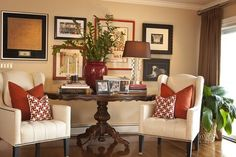 Warm burnt orange and brick red combined with neutrals in this eclectic sitting area.