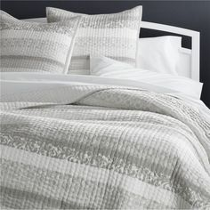 Our updated quilt bedding dresses the bed with intricate, small-scale stitching for rich depth and texture. Crafted of polyester and viscose in a versatile shade of cream, the bed linens have a slight sheen that makes them look modern. Quilts and shams are backed with cotton sheeting, filled with cotton and trimmed with cotton piping. Sham has overlap back closure.<br /><br /><NEWTAG/><ul><li>100% cotton, backing and fill</li><li>Sham has overlap back closure</li><li>Machine wash cold…