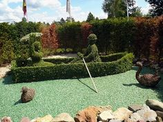topiary hedge mazes | china link gravity defying dolphin topiary link row boat topiary