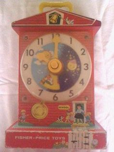Fisher Price music box teaching clock vintage time telling clock 1960s ...I remember this as a child!