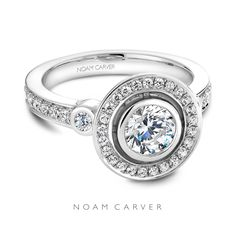 All around perfection, by Noam Carver.  Engagement ring by Noam Carver, round cut, halo.