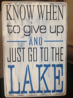Large wood lake sign know when to give up and just go by djantle