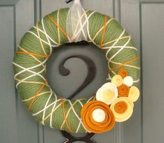 love the orange, yellow, and white yarn on the green!