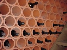 Terracotta drainage tiles for a wine rack.-- on colored wall? Latin Decor, Wine Cellar Racks, Wine Cellars, Drain Tile, Clay Pipes, Barolo Wine, Wine Rack Storage, Wine Shelves, Wine Case